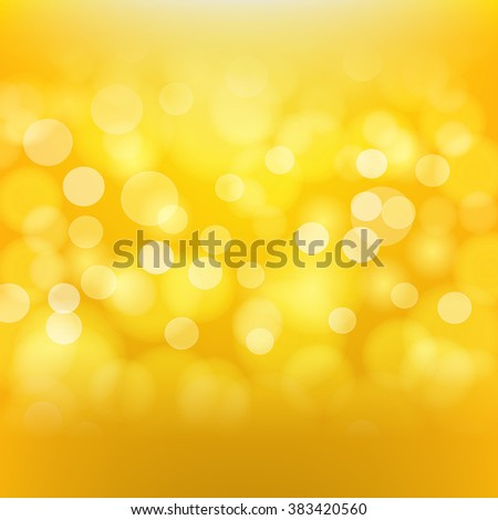 Golden background with blurred light effects. Vector