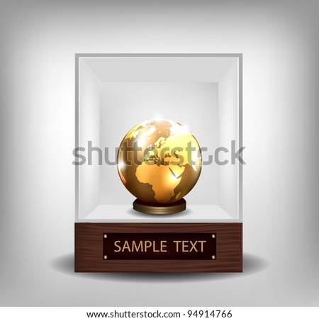 Golden globe in exhibition glass spot