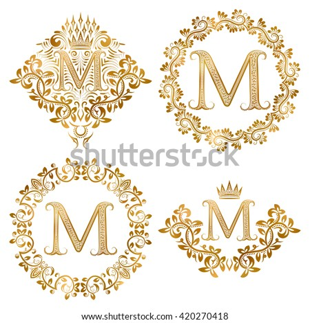 Golden letter M vintage monograms set. Heraldic coats of arms and round frames. - stock vector
