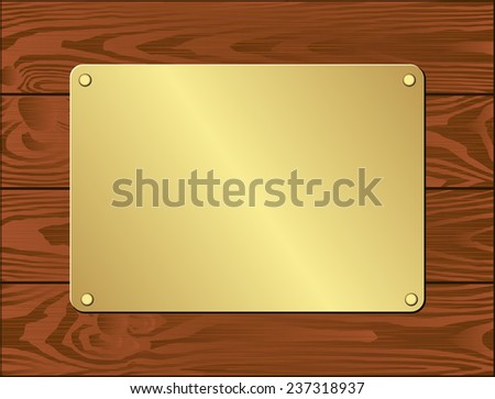 golden plate on dark wooden planks