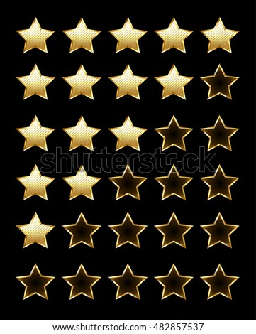 Golden shiny rating stars on a black background. Design with gold stars.