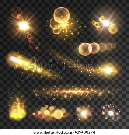 Golden sparkling light trails. Sparkling glitter flashes. Shining particles with sparkler tails. Burning fire flame. Lens flare effect on transparent background