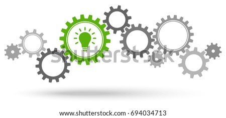 gray gear wheels with green light bulb symbolizing idea or solution