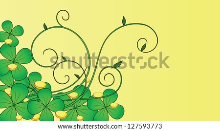 green clover with coins on a yellow background