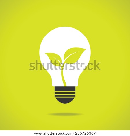 Green eco energy concept, plant growing inside the light bulb.