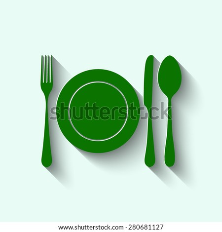 Green plate with spoon, knife and fork with shadow