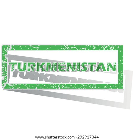 Green stamp with name Turkmenistan and shadow, isolated on white