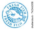 Grunge rubber stamp with fish shape and the word Fresh fish written inside, vector illustration - stock vector