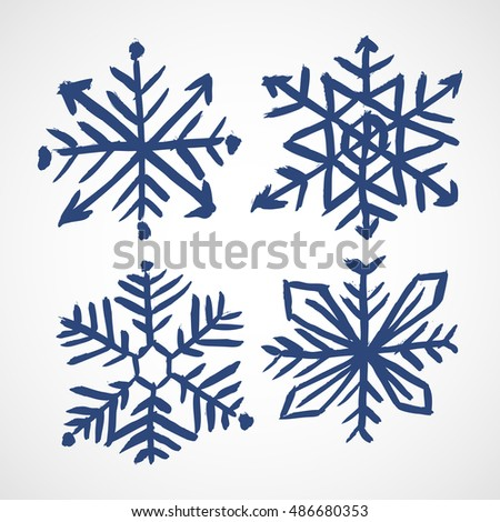 Grunge snowflakes. Four color grunge snowflakes on the white background. Vector illustration.