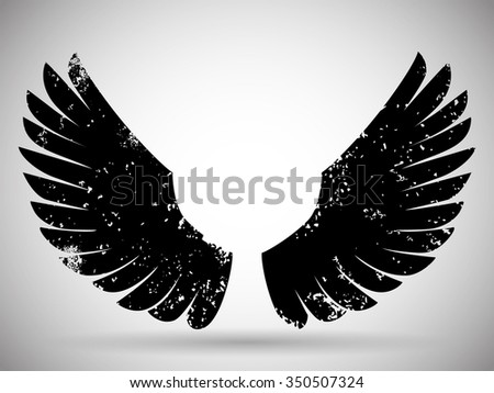 Grunge wings - stock vector
