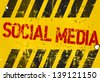 grungy social media sign, w. hazard stripes - stock photo