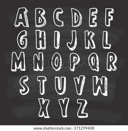 hand drawn alphabet on chalkboard background