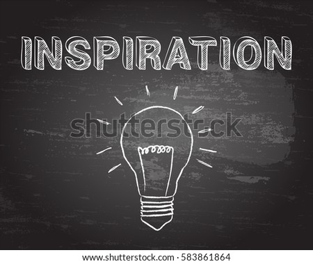 Hand drawn Inspiration sign and lightbulb on blackboard