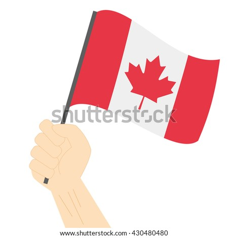 Hand holding and raising the national flag of Canada - stock vector