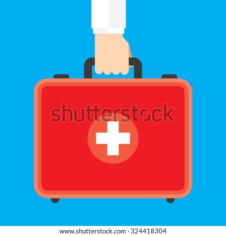 Hand Holding First Aid Box - stock vector