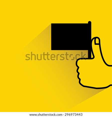hand holding flag on yellow background, flat and shadow theme