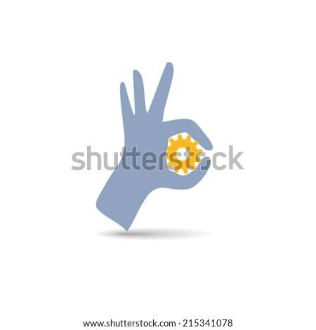 Hand holding gear - stock vector