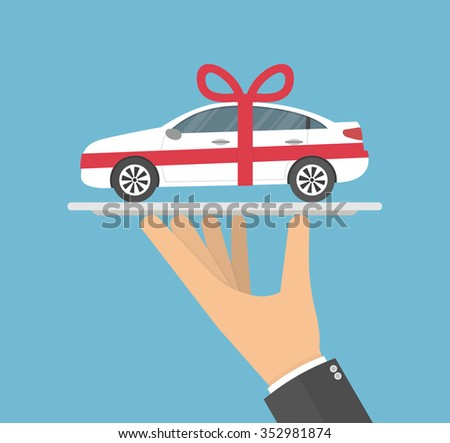 Hand holding white gift car with a red bow on it on a silver serving tray. Flat style - stock vector