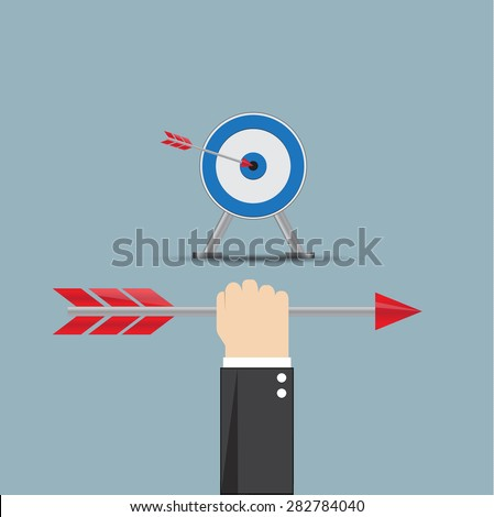 Hand of business with arrow.and arrow hitting the center bulls-eye in archery target. - stock vector
