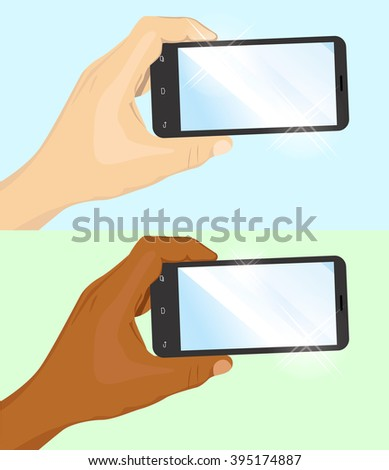 hand of Caucasian and African American man holding black horizontal smartphone