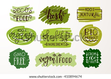 Hand sketched badges and labels with vegetarian, vegan, raw, eco, bio, natural, fresh, gluten and GMO free food design. Organic food elements set for cafe, restaurant and organic product packaging - stock vector