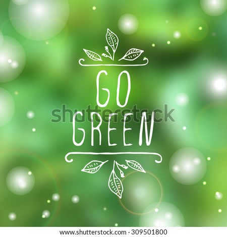Hand-sketched typographic element. Go green - product label on blurred background. Suitable for ads, signboards, packaging and identity and web designs. - stock vector
