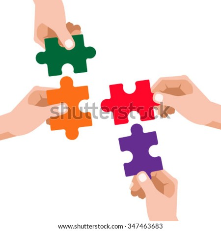 Hands assembling jigsaw puzzle pieces together