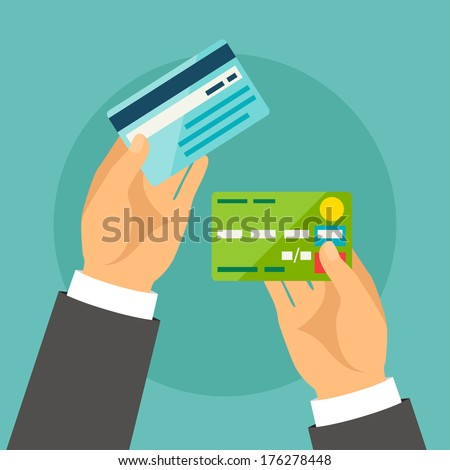 Hands holding bank cards in flat design style. - stock vector
