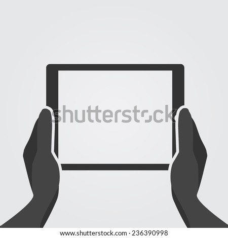 Hands holding tablet computer with blank screen.