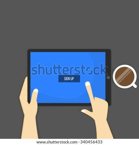 Hands holding tablet, sign up button