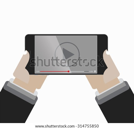 Hands holing Smartphone with video player on the screen