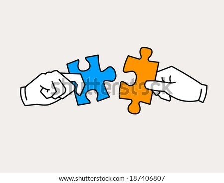 Hands joining jigsaw puzzle pieces. Friends, partners in harmony concept.
