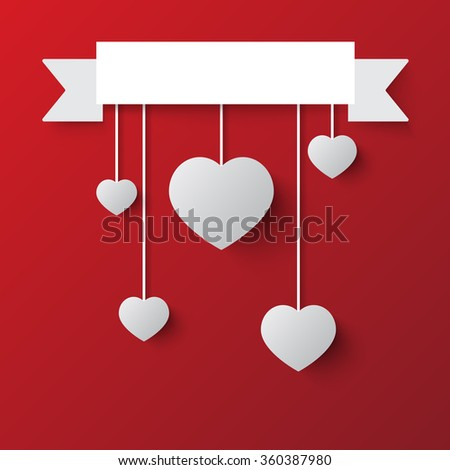 hanging hearts and ribbon on background