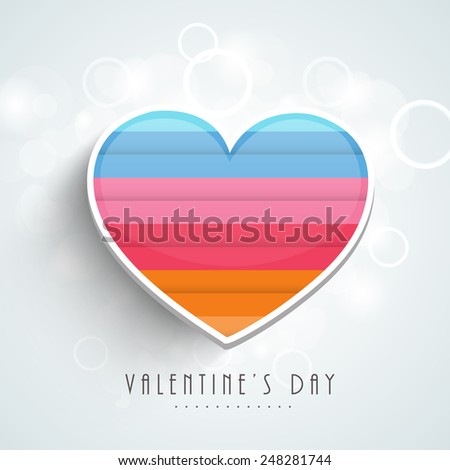 Happy Valentine's Day celebration love greeting card with colorful heart on shiny sky blue background.