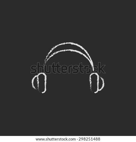 Headphone hand drawn in chalk on a blackboard vector white icon on a black background - stock vector