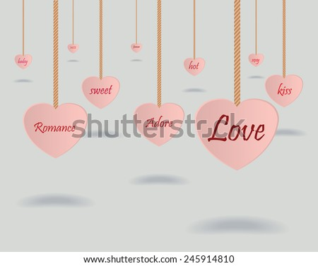 Hollow hearts with text, hanging from ropes