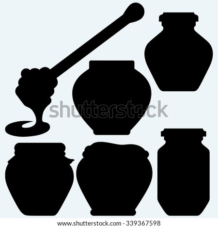 Honey dipper and honey in jar. Isolated on blue background. Vector silhouettes