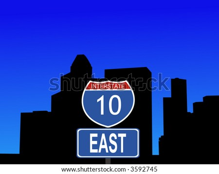 Houston skyline with close view of interstate 10 sign