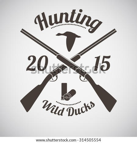Hunting Vintage Emblem. Cross Hunting Gun With Ammo and Flying Duck Silhouette. Suitable for Advertising, Hunt Equipment, Club And Other Use. Dark Brown Retro Style.  Vector Illustration.  - stock vector