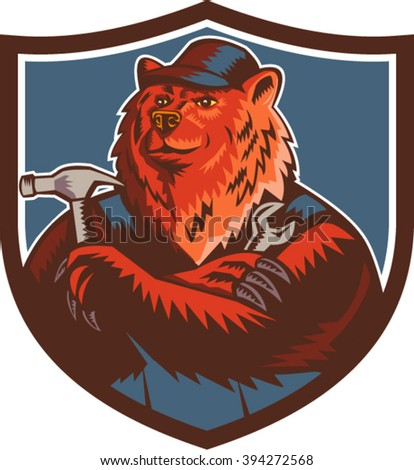 Illustration of a builder handyman Russian bear or Eurasian brown bear wearing hat arms folded with tools hammer and wrench facing front set inside crest shield done in retro woodcut style.  - stock vector