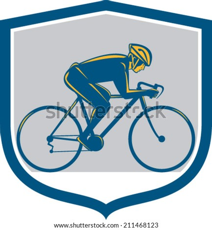 Illustration of a cyclist biking riding mountain bike facing side set inside shield on isolated background done in retro style.
