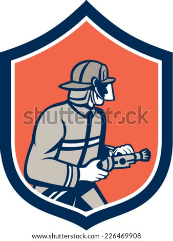 Illustration of a fireman fire fighter emergency worker with fire hose facing side set inside shield crest on isolated background done in retro style.