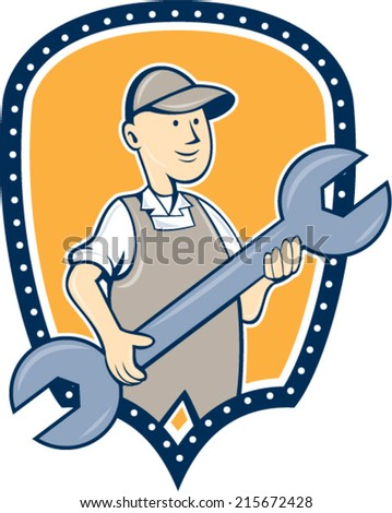 Illustration of a mechanic holding spanner wrench facing front set inside shield crest on isolated background done in cartoon style.