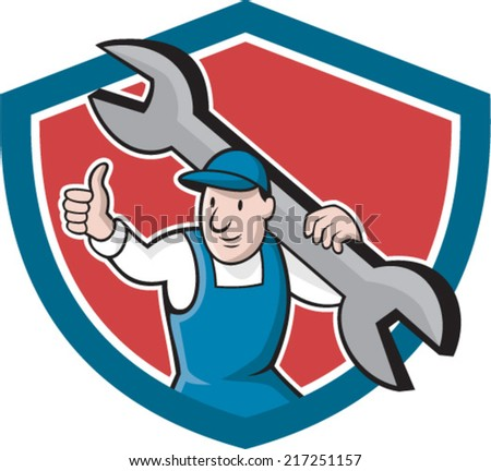 Illustration of a mechanic thumbs up holding spanner wrench on shoulder set inside shield crest on isolated background done in cartoon style.