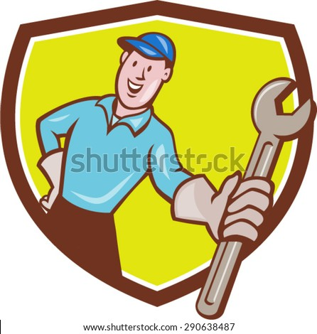 Illustration of a mechanic wearing hat and gloves holding presenting wrench spanner facing front set inside shield crest on isolated background done in cartoon style.