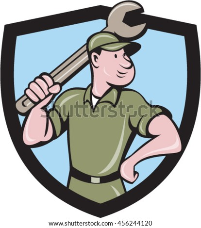 Illustration of a mechanic wielding holding spanner wrench looking to the side with one hand on hips viewed from front set inside shield crest on isolated background done in cartoon style.  - stock vector