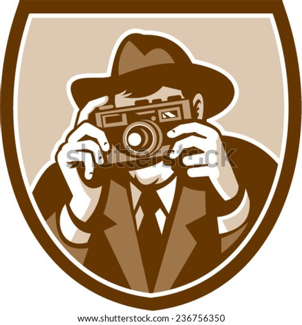 Illustration of a photographer shooting aiming with vintage camera facing front set inside shield crest on isolated background done in retro style.  - stock vector