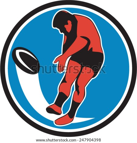 Illustration of a rugby player kicking ball front view set inside circle on isolated background done in retro style. - stock vector