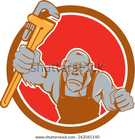 Illustration of an angry gorilla ape plumber with monkey wrench punching facing front set inside circle on isolated background done in cartoon style.