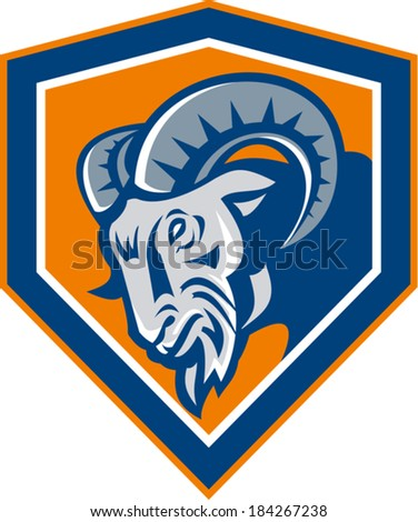 Illustration of an angry ram mountain goat head facing side set inside shield done in retro style.